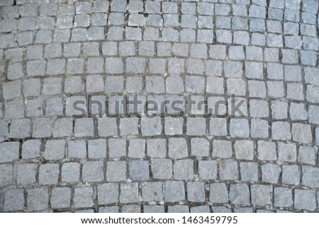 Texture of old Cobbled Pavement close-up. Abstract Granite Stones in a Row  Background.