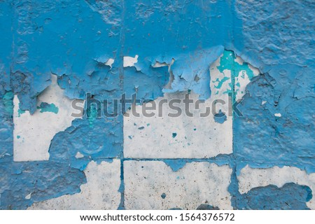 Photo of  Texture of old peeling paint, vintage graffiti background, it's time to make repairs, cracked paint texture.  Clipart, white, blue old paint, cracked paint