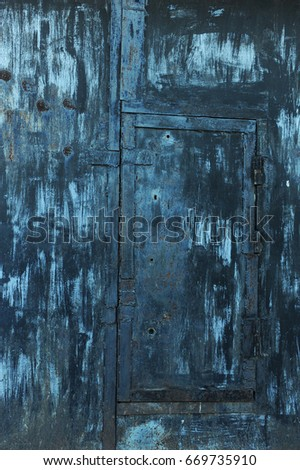Texture of old shabby metal surface. Cracks, scrapes and bright spots of colored paint #669735910