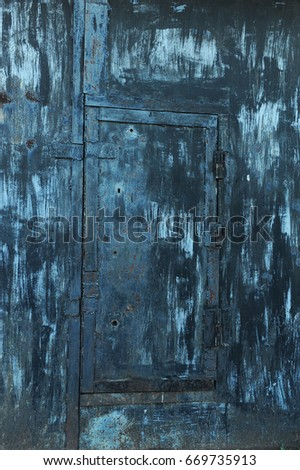 Texture of old shabby metal surface. Cracks, scrapes and bright spots of colored paint #669735913