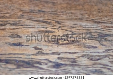 Texture of old wooden table top closeup, taupe color. Soft focus with shallow depth of field. #1297275331
