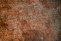 Texture of old wooden table with scratches and stains. Burgundy vintage background.