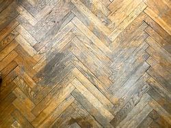 Texture of old worn parquet floor, close up