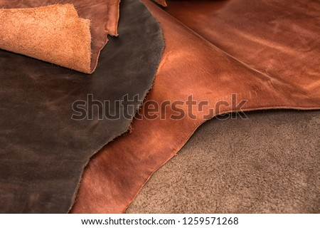 Texture of pieces brown leather. Natural material background Stock fotó ©