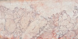 Texture of red and yellow marble. Stone tile with natural pattern. Marble pavement closeup.