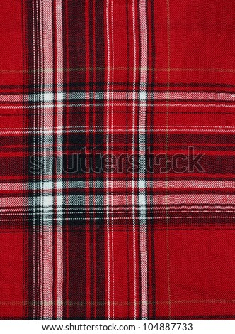 Texture of red-black checkered fabric pattern background