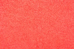 Texture of red foam rubber, fine sponge material for supplies shipping or mailing