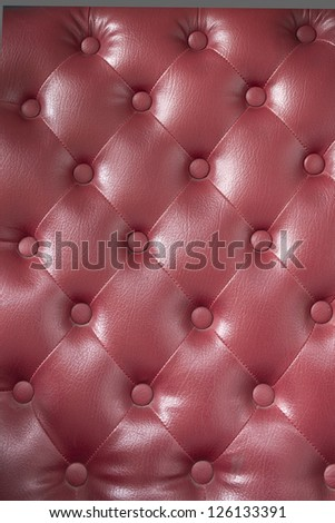 Texture of Red leather of sofa background