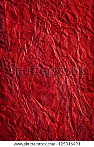 Texture of red Valentine crumpled wrapping paper