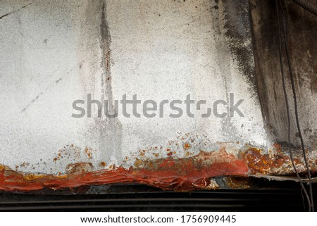 texture of rusty iron, cracked paint on an old metallic surface, sheet of rusty metal with cracked and flaky paint, abstract rusty metal texture, rusty metal background for design.