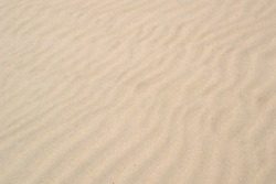 Texture of sand in a wave mode on the coast of the sea