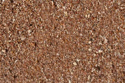 texture of small stones and sand. Background from beach pebbles. View from above. blank for text. High quality photo