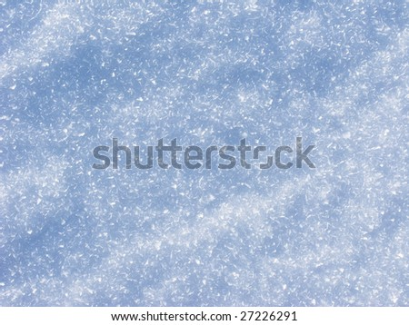 Texture of snow surface on sunny day