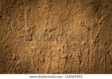 Texture of soil wall of traditional house  in Northern of Thailand