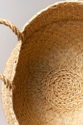 Texture of straw weaving closeup. Straw wicker basket. Fashionable bamboo basket, stylish interior item, eco design, handmade. Natural decor. Straw weave texture. Natural eco materials, storage basket