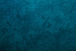 Texture of stucco painted in a heterogeneous turquoise color