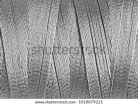 texture of synthetic thread in spool, macro #1018079221