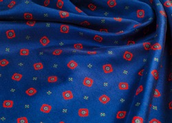 texture of the silk fabric with an abstract pattern, a pattern of tiny red quadrangles.