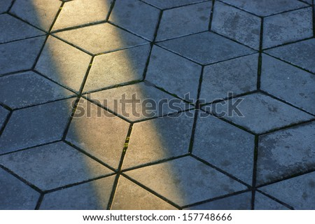 texture of the tile with a ray of sunshine
