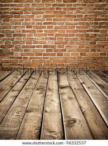 Texture of vintage brick wall and wooden floor interior