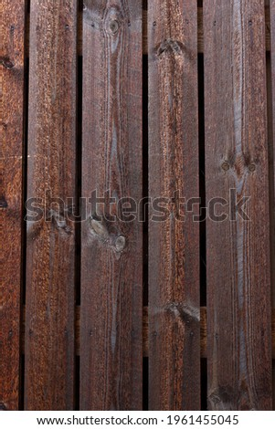 Texture of vintage style barn wall made from homemade rough sawn timber. Knotty boards treated with varnish and pine tar. Stock photo ©