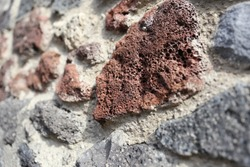 Texture of wall in ancient italian ruins of Pompeii. Investigation of ancient building technologies and materials in Roman Empire.