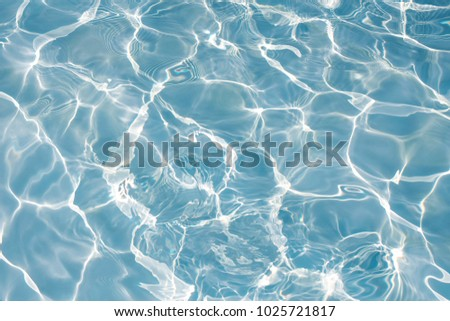 Texture of water in swimming pool for background #1025721817