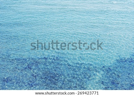 Texture of water. Shallow sea beach with transparent water.