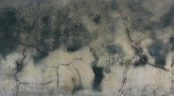 texture of wet concrete wall with dark green humidity blurred marks - moisture backgrounud surface for a wallpaper