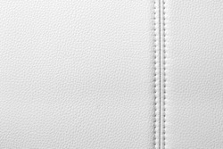 Texture of white leather, seam, close-up