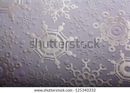 texture of white paper with a textured snowflakes for card