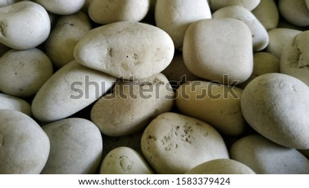Texture of white pebbles. pebbles suitable for decorating a room with a natural theme