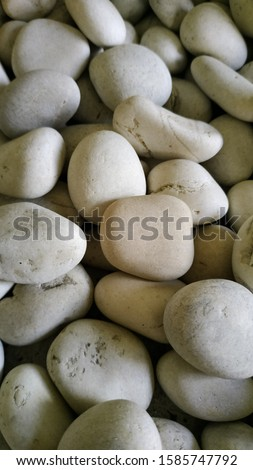 Texture of white pebbles. pebbles suitable for decorating a room with a natural theme. Selective focus