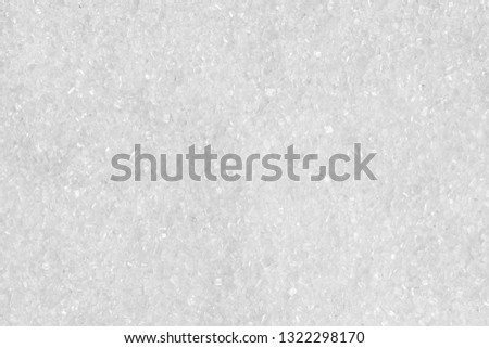 Texture of white refined sugar. macro photography. Sugar crystals closeup. Abstract white background. You can place your text.