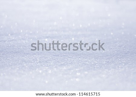 texture of white snow sparkling in the sun - stock photo