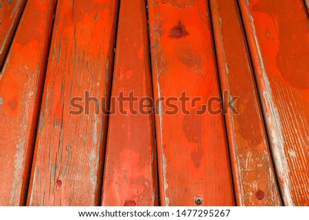 Texture of wood background, planks background of curved planks, old red board paint.