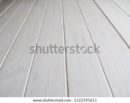 Texture of wood painted white with wood grooving.