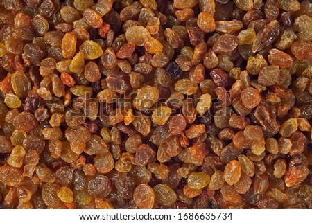 Texture of yellow and orange raisins. Dry raisins on the pile. Stock photo ©