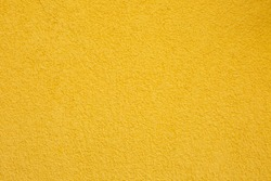 Texture of yellow concrete wall