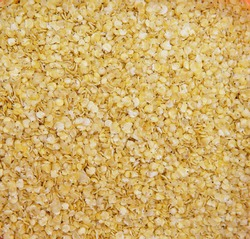 texture of yellow millet flakes. Millet flakes as an idea for a tasty and healthy breakfast