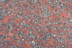 Texture of yellow, red and orange marble. Stone tile with natural pattern. Marble pavement closeup.