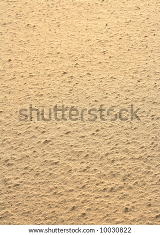 Texture of yellow sand in sunny day.