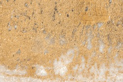 Texture of yellow sand on white ice. Sand is poured onto ice for safe movement, pedestrian care, traffic safety. Can be used as a natural background, design element.