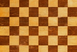 texture old scratched chess board.checkerboard background close up