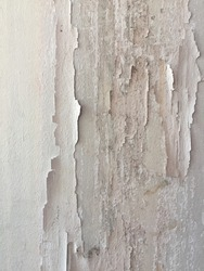 Texture, pattern, background. old paint. Concrete wall cracked paint, paint abstractly behind the concrete. With white tone paint flakes off over time