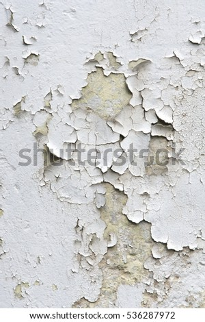 Texture, pattern, background. old paint. Concrete wall cracked paint, paint abstractly behind the concrete. With white tone paint flakes off over time Stock photo ©