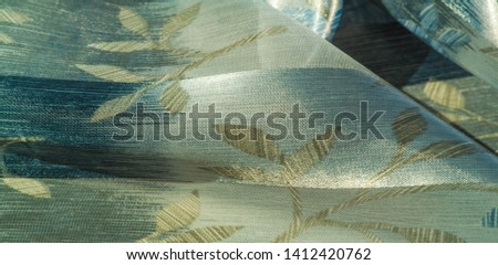 texture, pattern, background. This beautiful fabric is decorated with metallic silver lurex with an abstract pattern, which creates a great visual interest. Ideal for adding elegance to your designs #1412420762