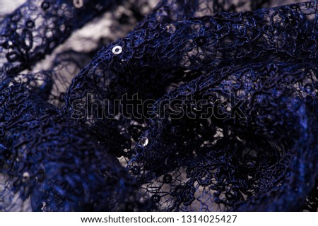 Texture, pattern, lace blue on a white background. Delicate and classic, this sheer lace has no significant stretch and pearlescent shine. This lace fabric is suitable for your design,