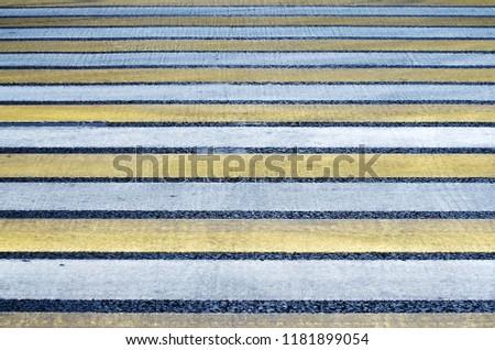 Texture. Pedestrian crossing the road. Zebra. #1181899054