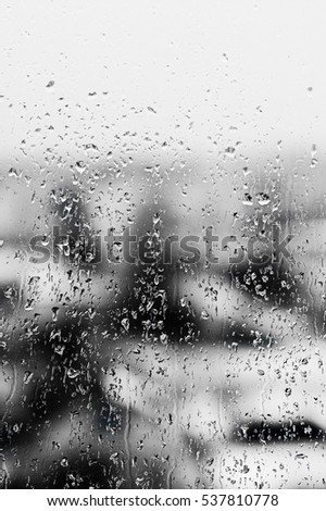 Texture Raindrops on  window glass for rain, black and white colors, photo, unusual background #537810778